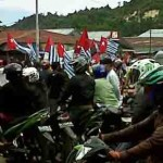 Mass flying of banned Morning Star flags at Serui, West Papua. Image courtesy of Pacific Scoop and West Papua Media.